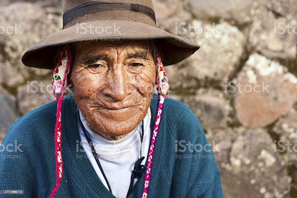 Portrait of Peruvian man selling coca leaves, Inca ruins, Pisac royalty-free stock photo