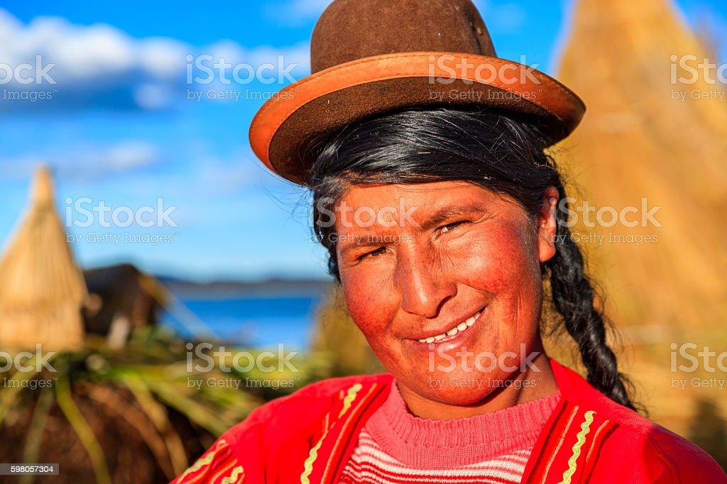 Portrait of Peruvian woman on Uros floating island, Lake Tititcaca stock photo