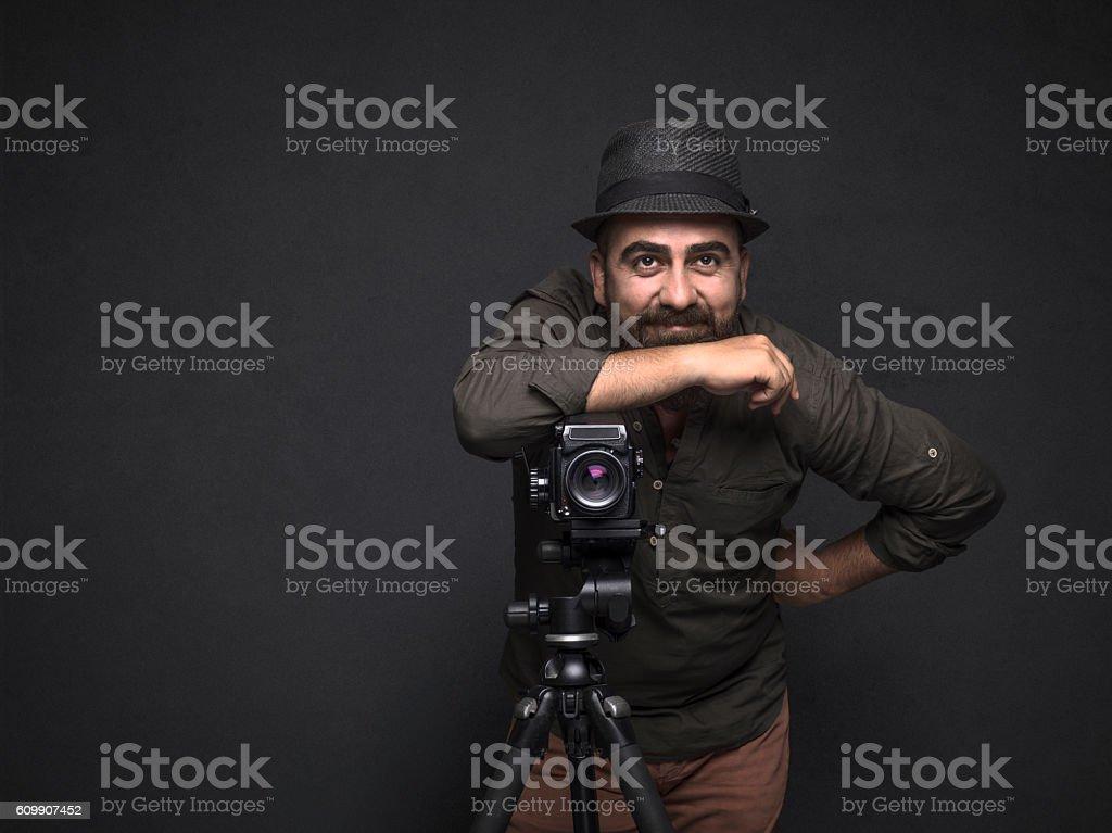 Portrait of photographer looking away stock photo