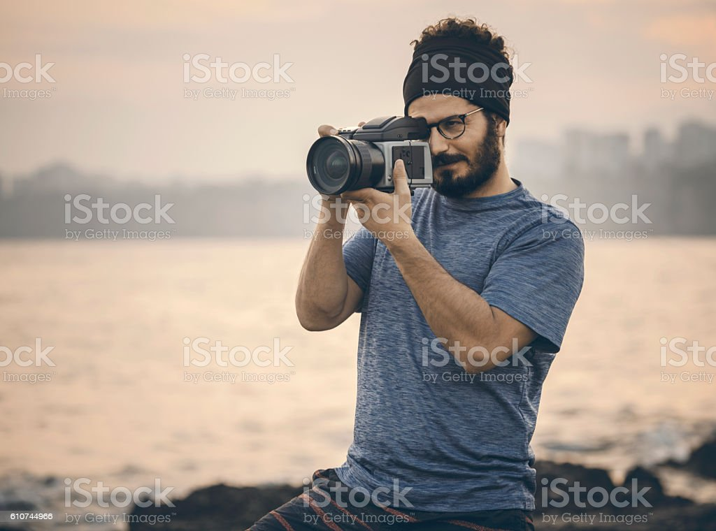 Portrait of photographer taking picture outdoor stock photo