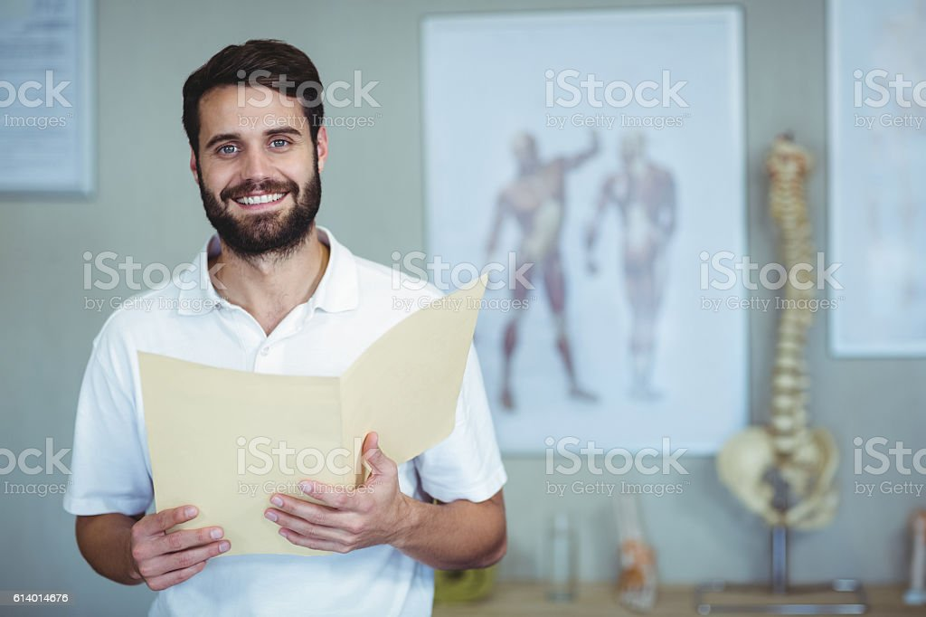 Portrait of physiotherapist holding file stock photo