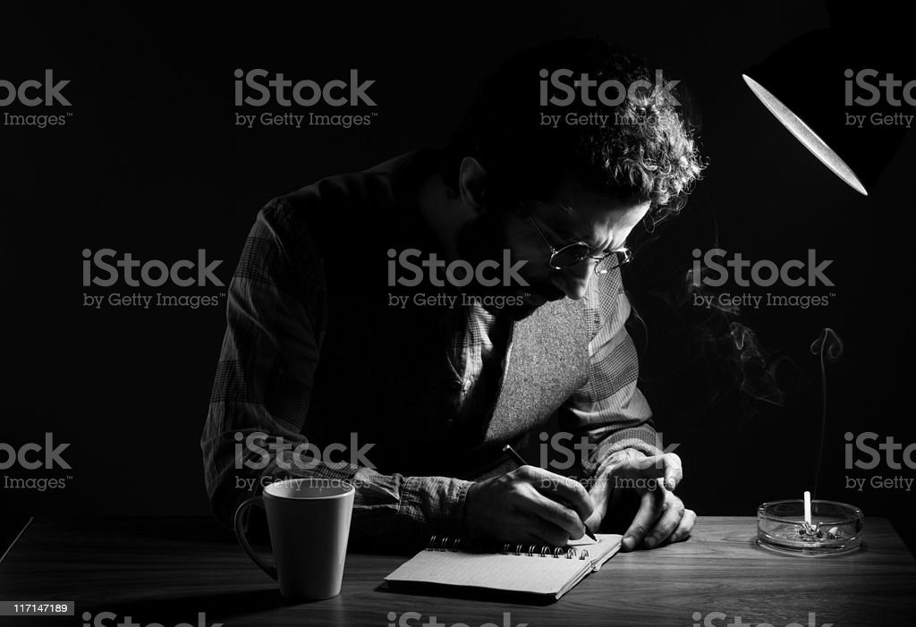 Portrait of Poet writing on table in the dark stock photo