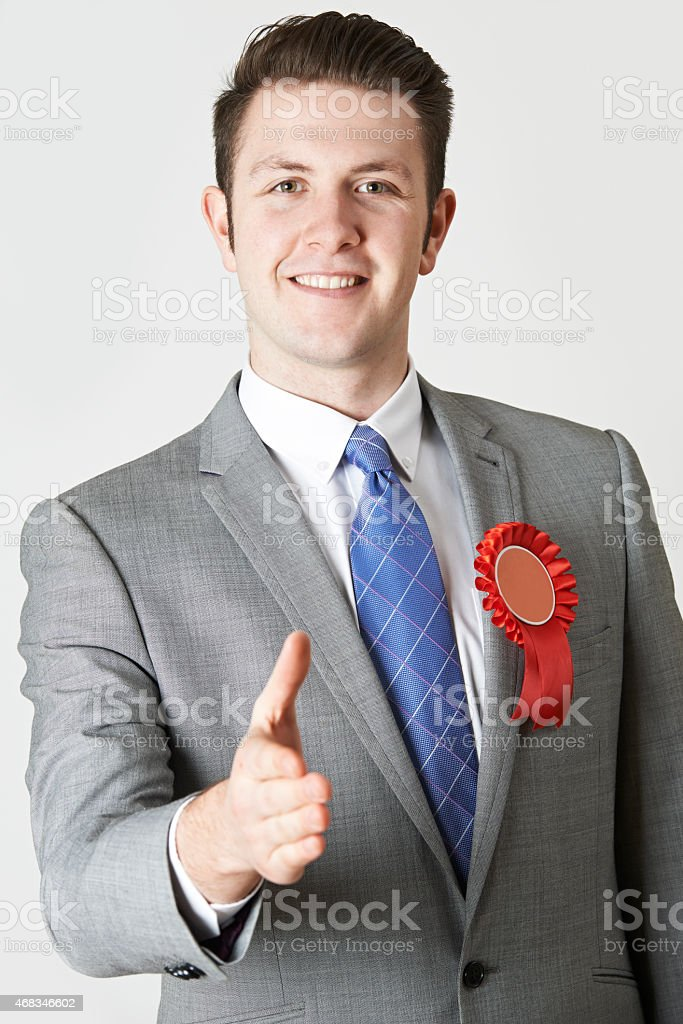 Portrait Of Politician Reaching Out To Shake Hands stock photo