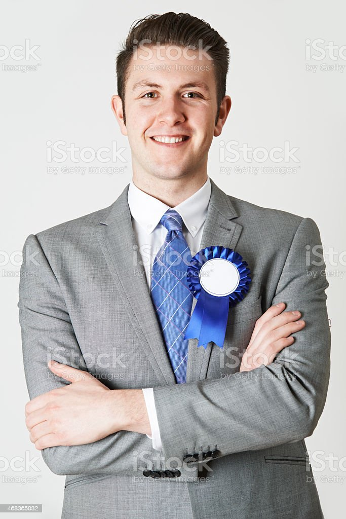 Portrait Of Politician Wearing Blue Rosette stock photo