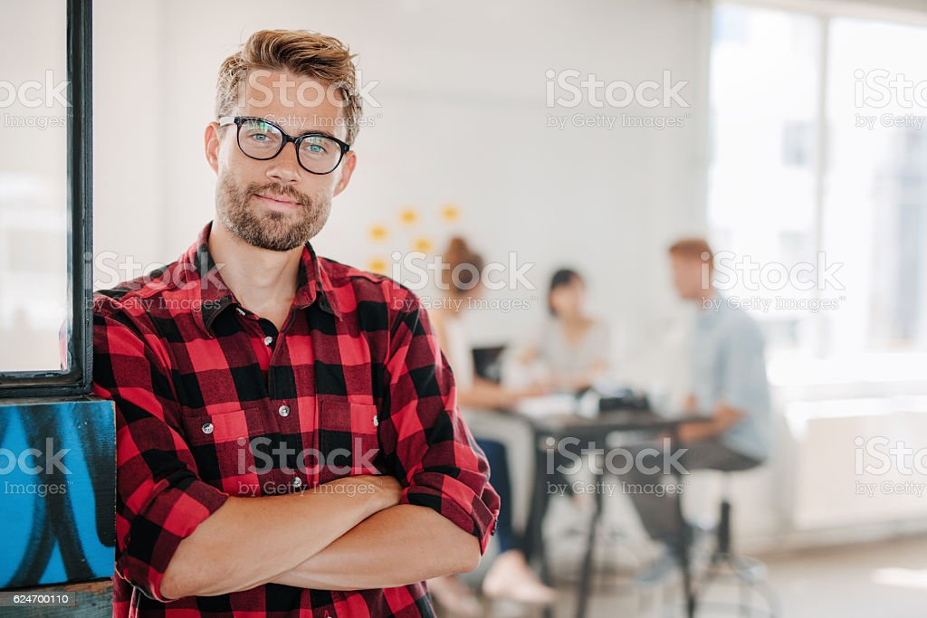 Portrait of positive businessman in office stock photo
