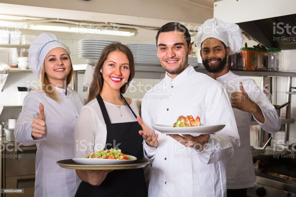 Portrait of positive kitchen workers stock photo