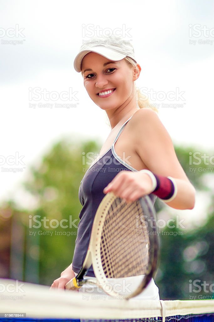Portrait of Positive Smiling Female Tennis Player stock photo