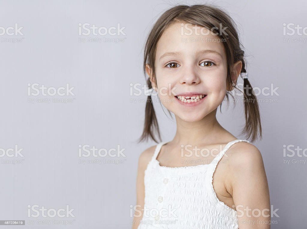 Portrait of preschooler girl with open mouth with molar stock photo