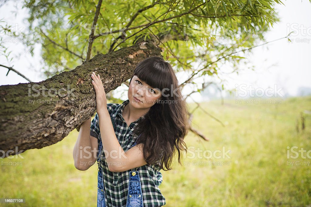 Portrait of pretty brunette holding the trunk royalty-free stock photo
