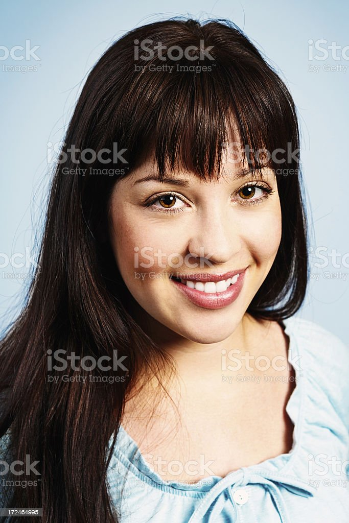 Portrait of pretty brunette smiling sweetly royalty-free stock photo