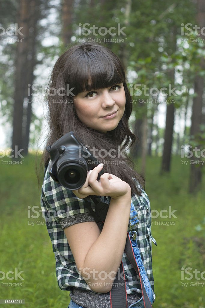 Portrait of pretty brunette taking pictures royalty-free stock photo