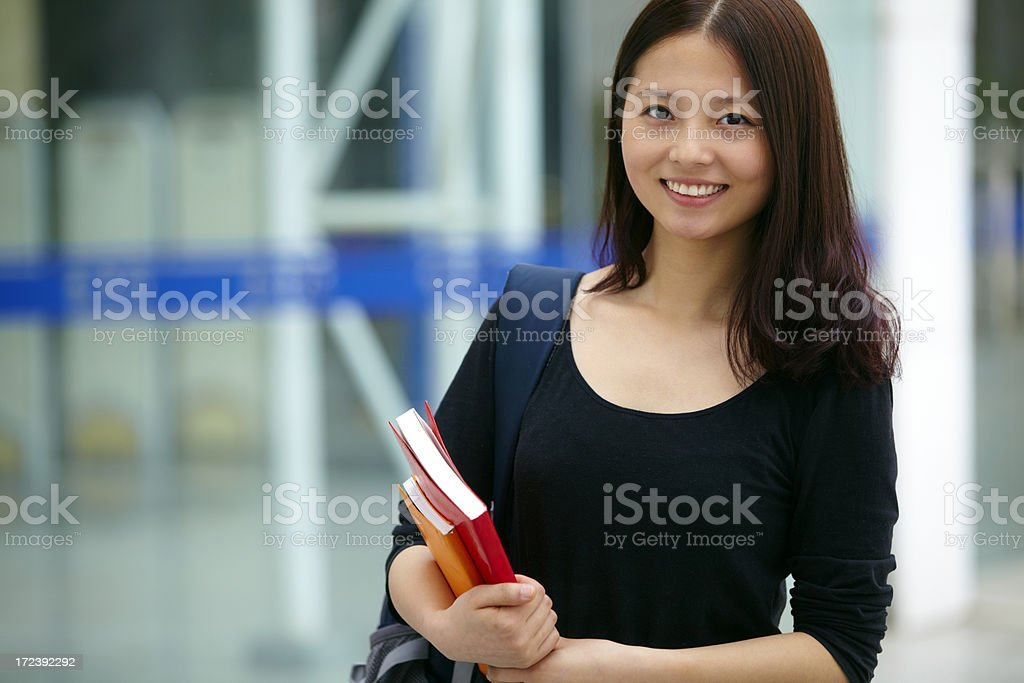 portrait of pretty female college student smile royalty-free stock photo