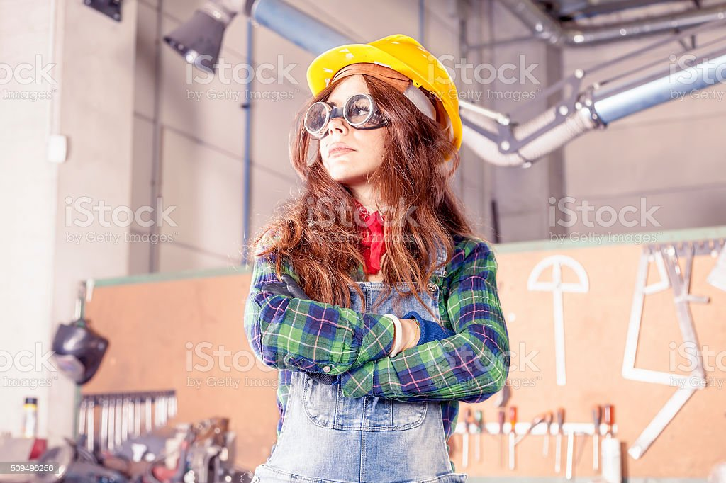 portrait of pretty female worker in a steel mill stock photo