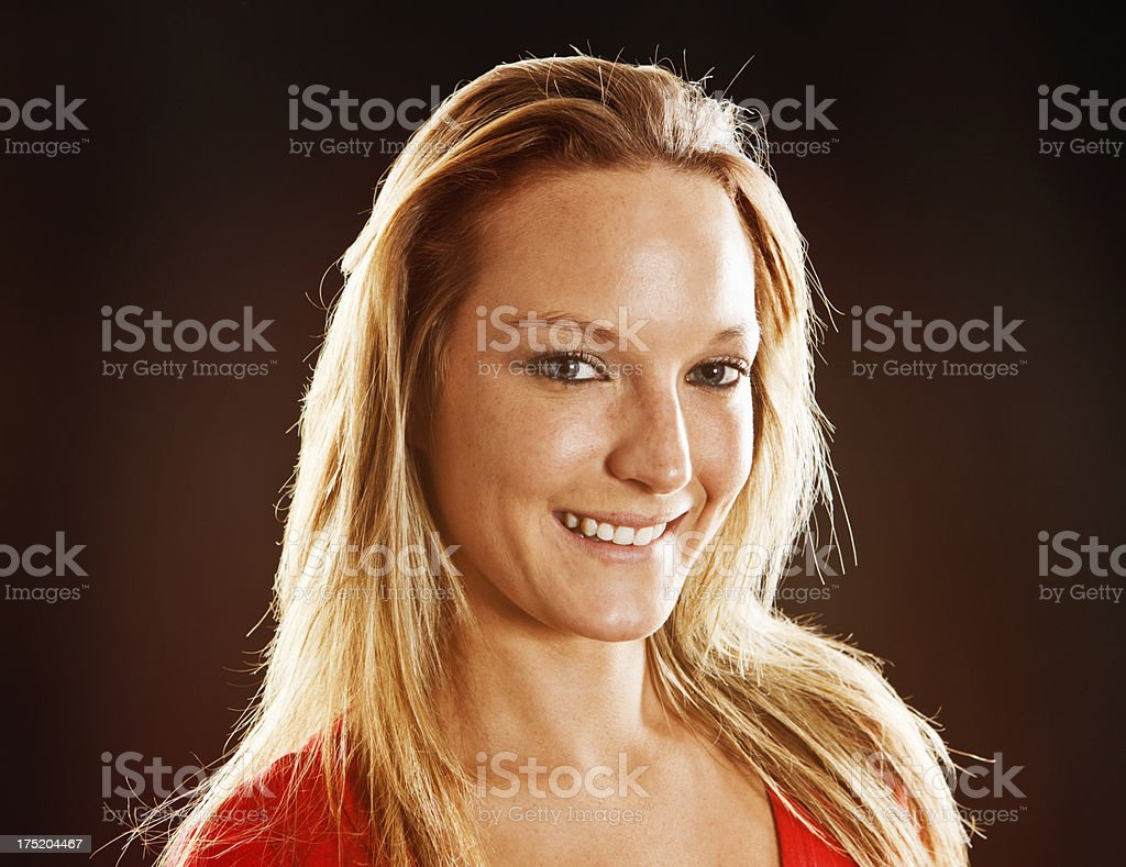 Portrait of pretty, freckled blonde smiling gently stock photo