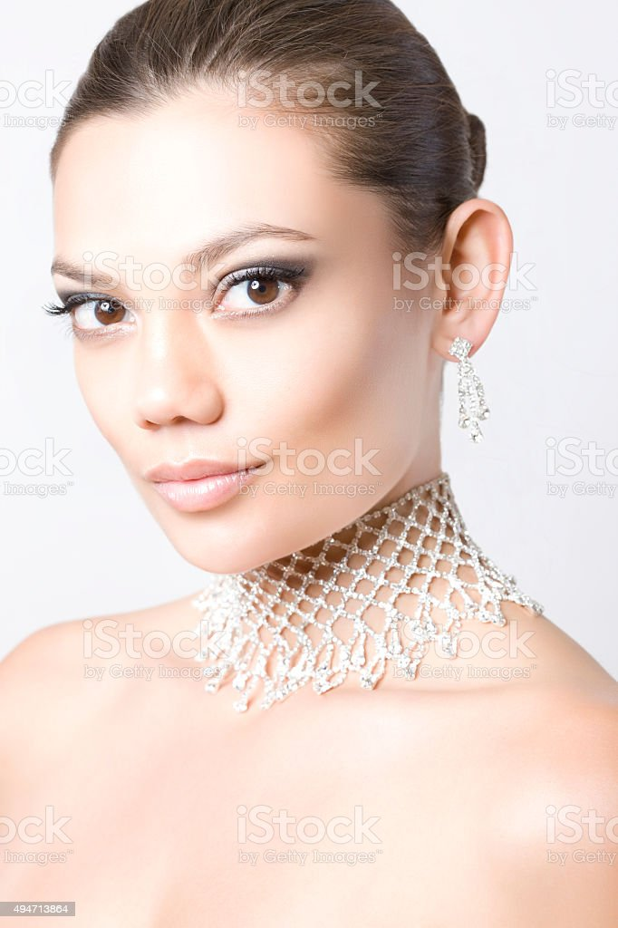 Portrait of Pretty Girl with Diamond Necklace and Earrings stock photo