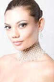 Portrait of Pretty Girl with Diamond Necklace and Earrings
