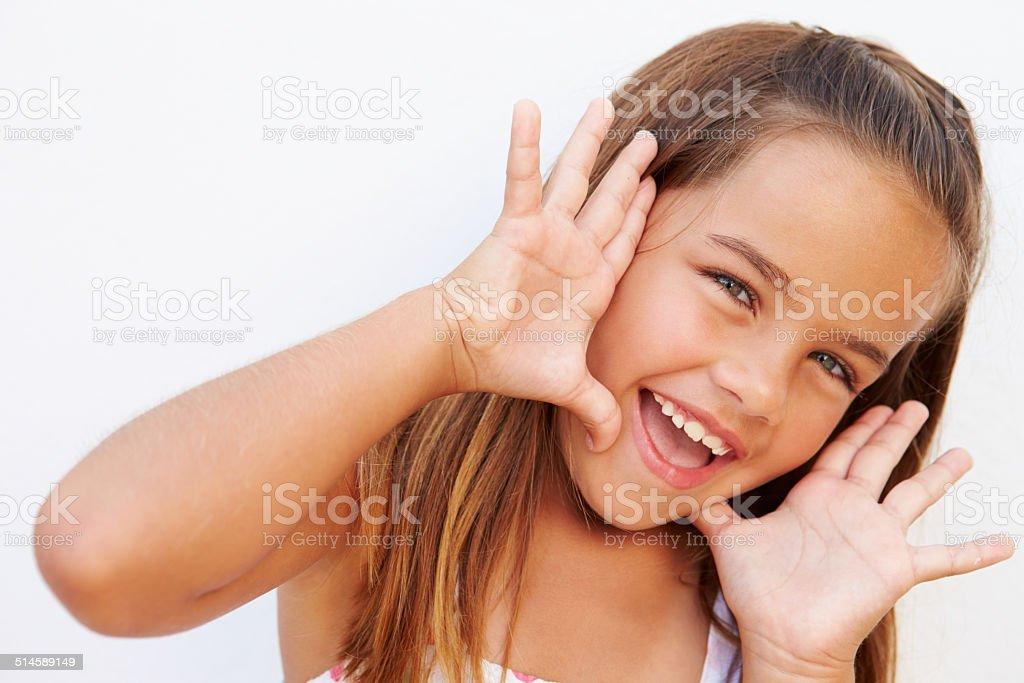 Portrait Of Pretty Hispanic Girl Shouting At Camera stock photo