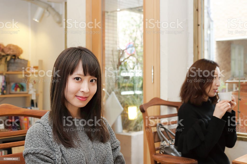 Portrait of pretty japanese woman in cafe stock photo