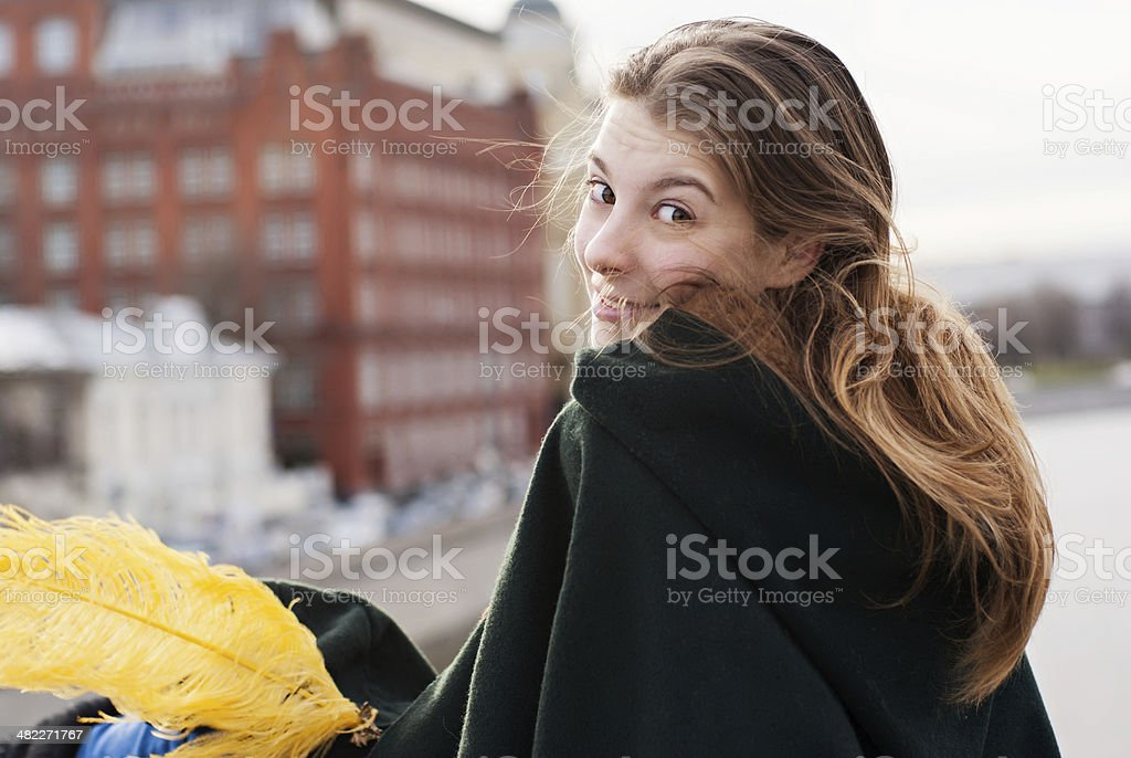 Portrait of pretty woman turning around and looking at you stock photo