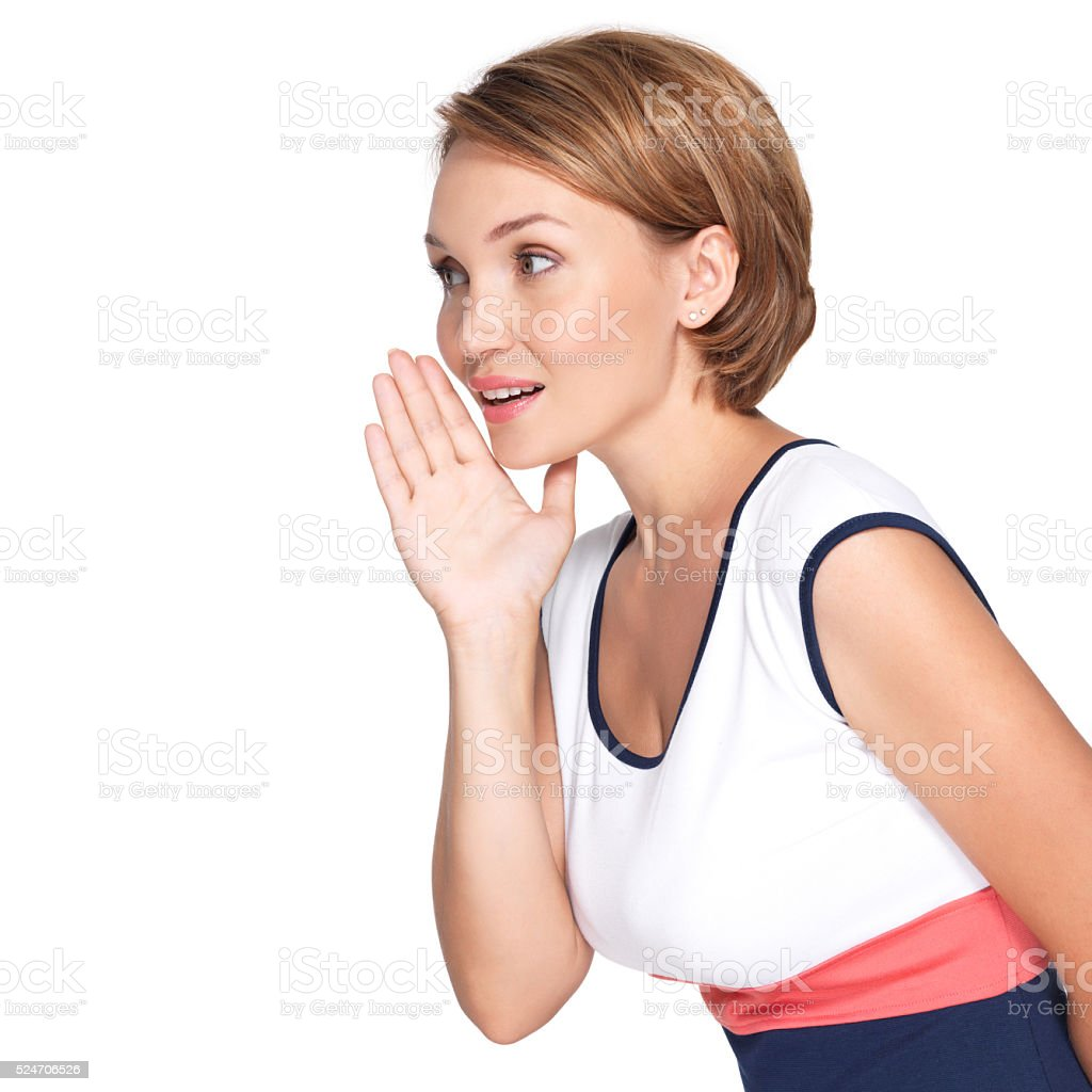 Portrait of pretty woman whispering gossip stock photo