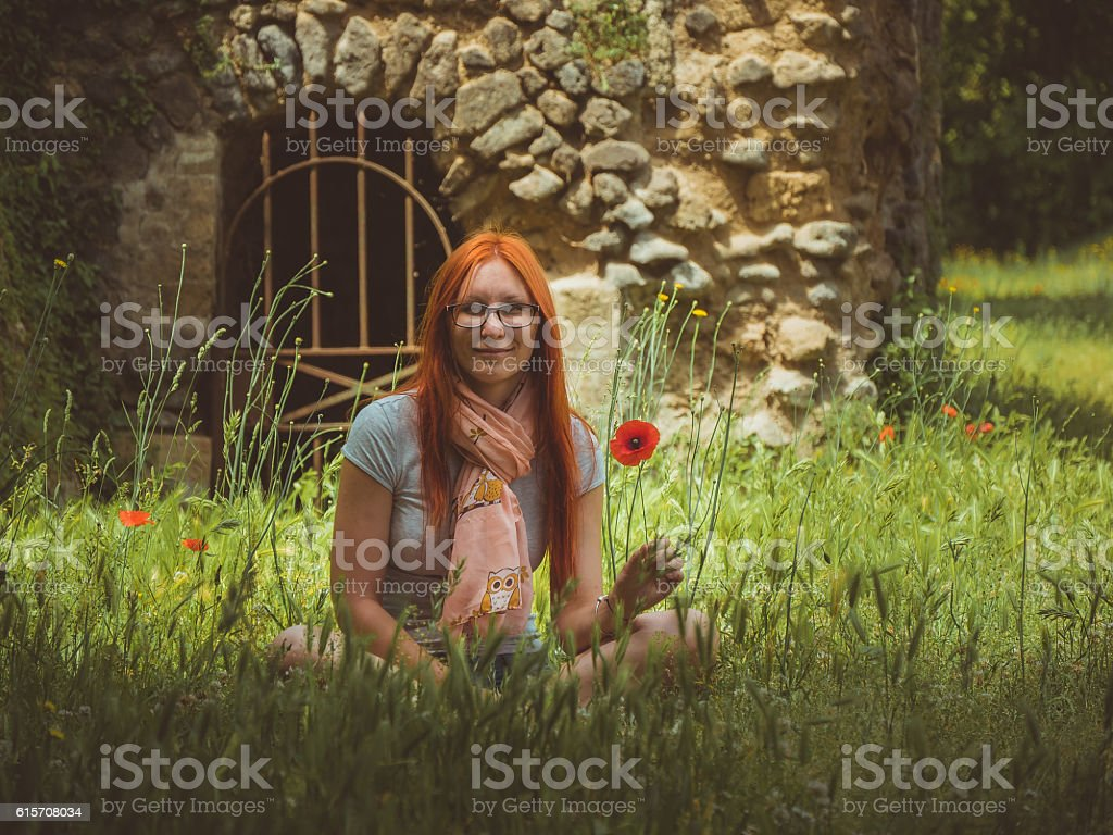 Portrait of pretty, young, cute woman in glasses sitting on stock photo