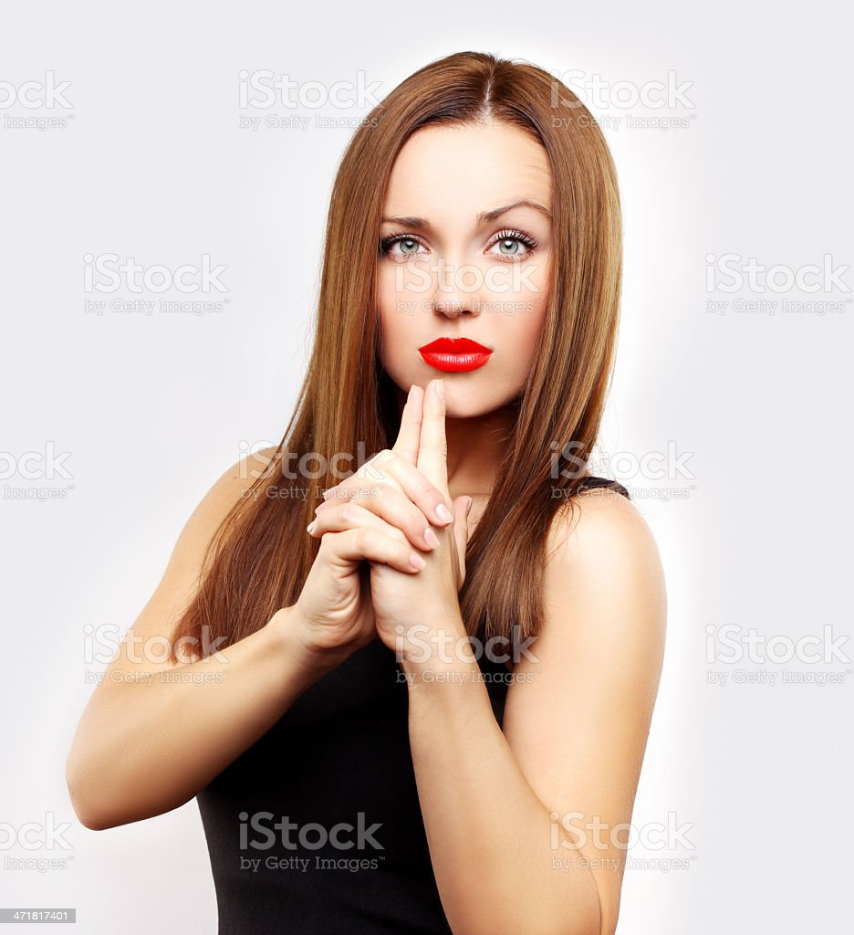 Portrait of pretty young woman  holding finger on her lips stock photo