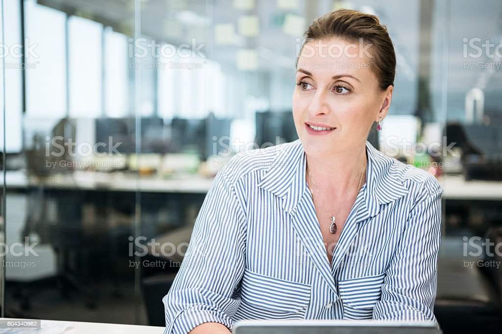 Portrait of professional businesswoman looking away, contented stock photo