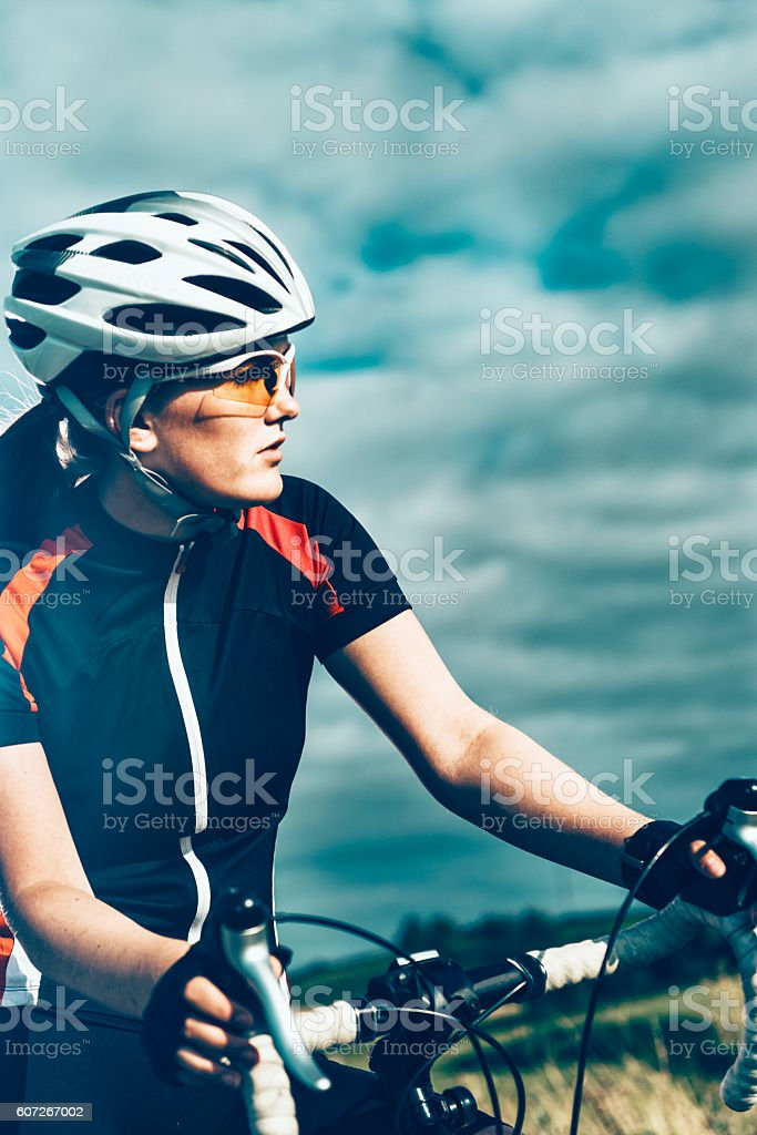 Portrait of professional female bike rider on the move stock photo