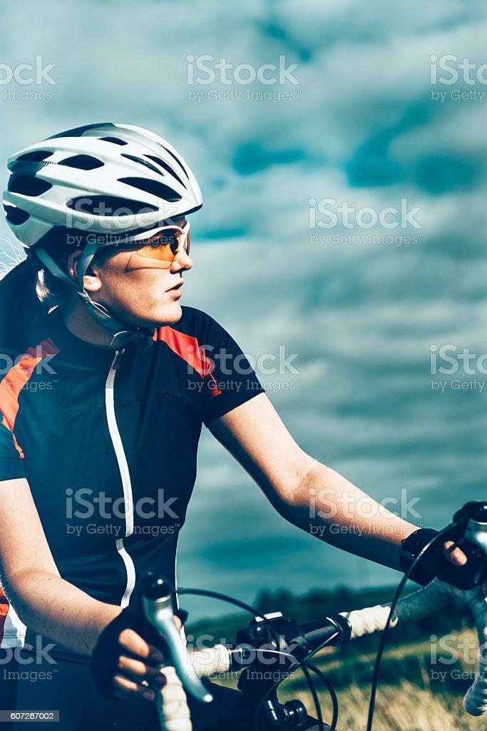 Portrait of professional female bike rider on the move stock photo