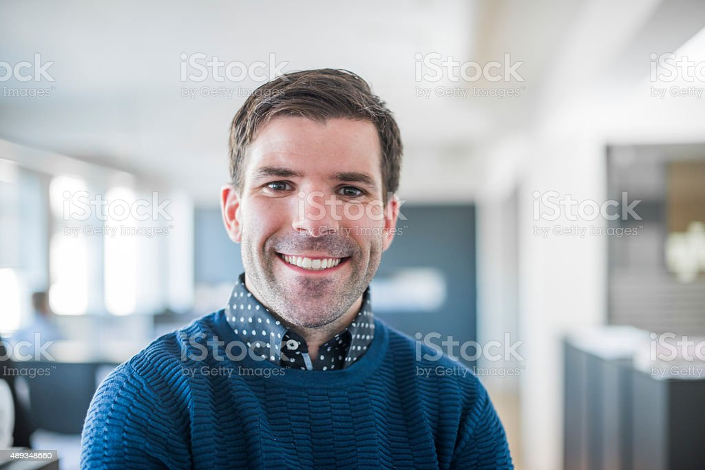 Portrait of professional smiling in office stock photo
