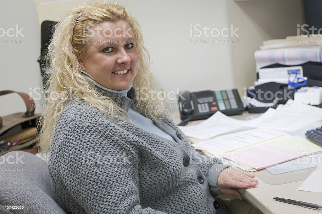 Portrait of professional woman working at her desk royalty-free stock photo