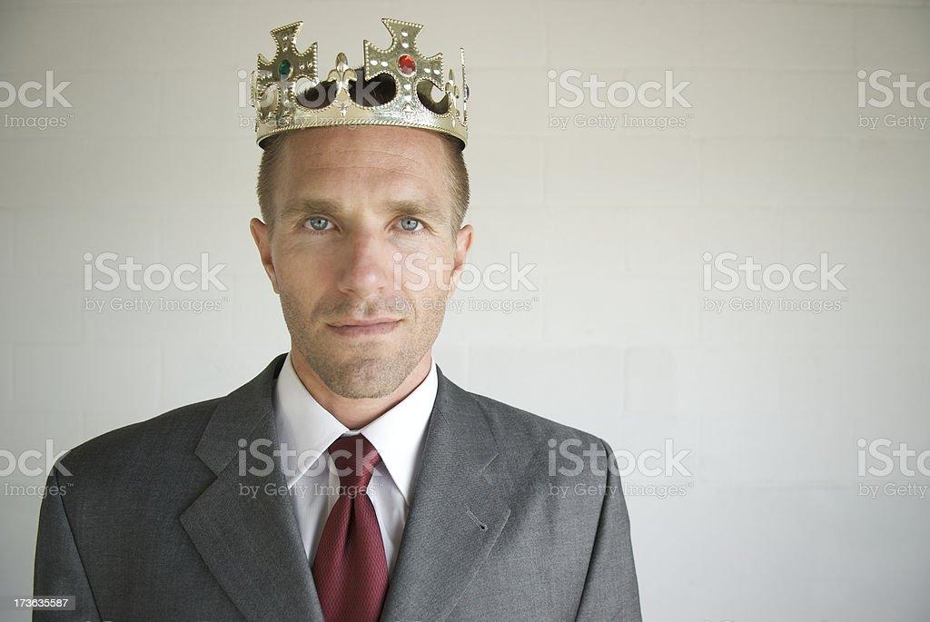 Portrait of Proud Rich Royal Businessman Gold Crown stock photo