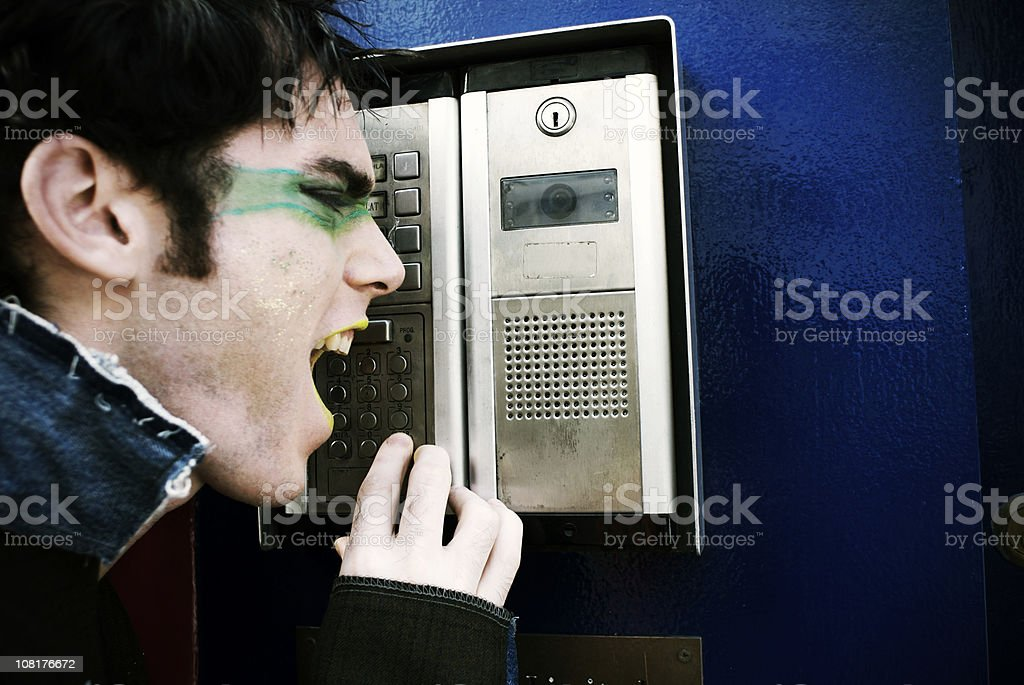 Portrait of Punk Man Shouting at Intercom royalty-free stock photo