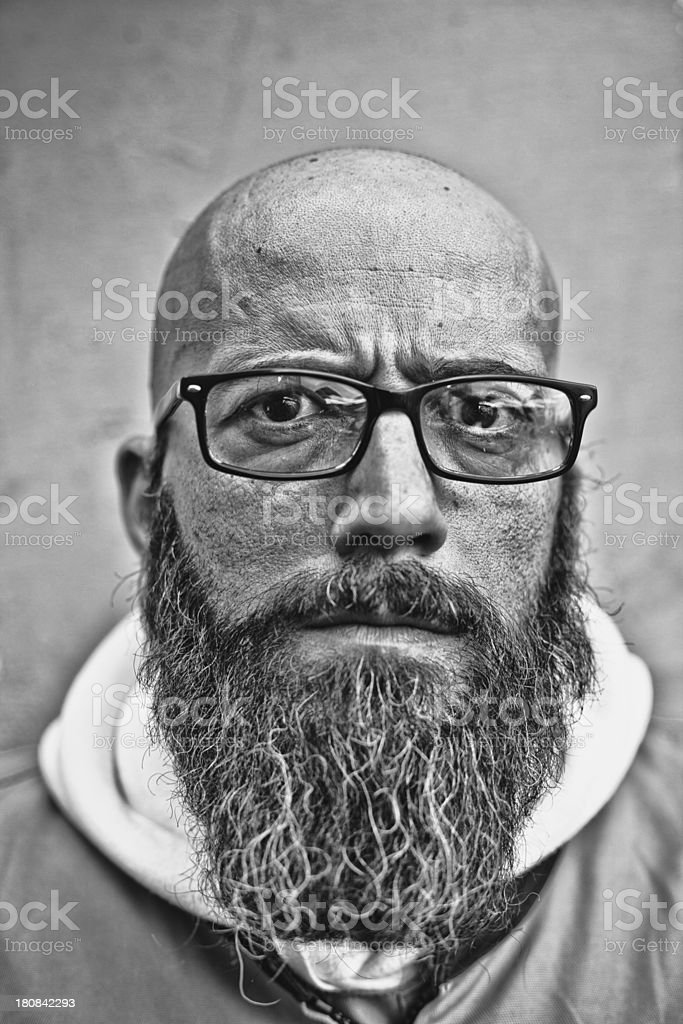 Portrait of Real Bald Man with Barb and Glasses royalty-free stock photo