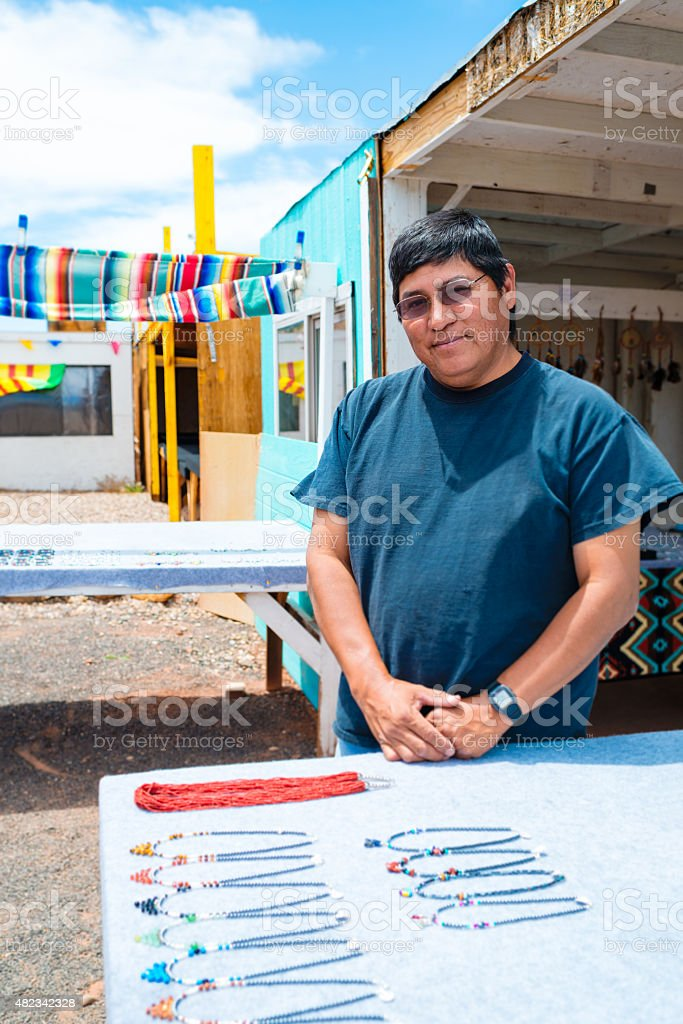Portrait of real Navajo man selling jewelry stock photo