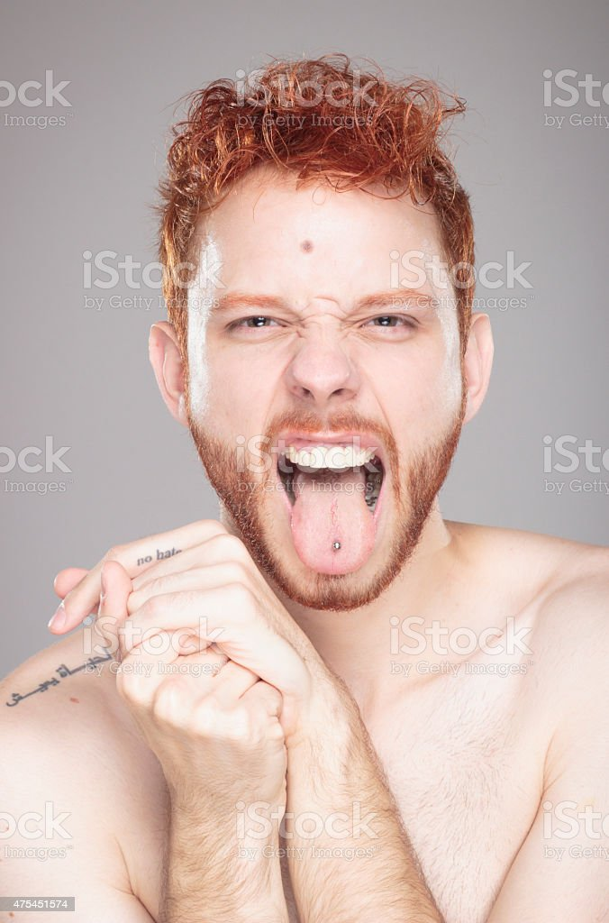 Portrait of red hair guy, having fun, shouting. stock photo