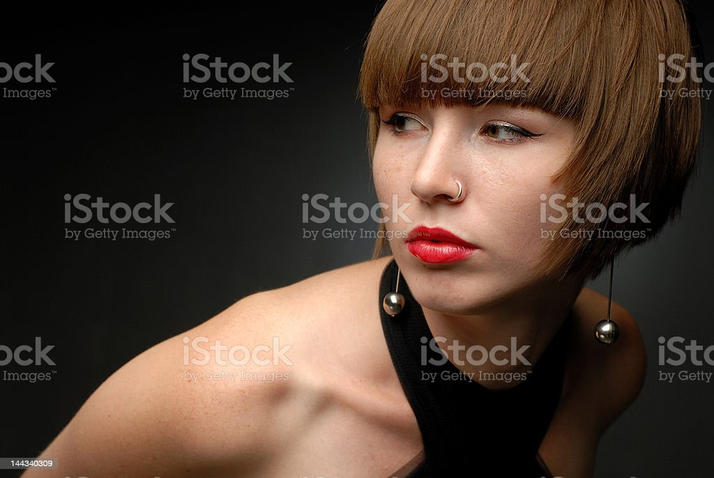 Portrait of red haired girl looking sideways arm stretched horizontal royalty-free stock photo