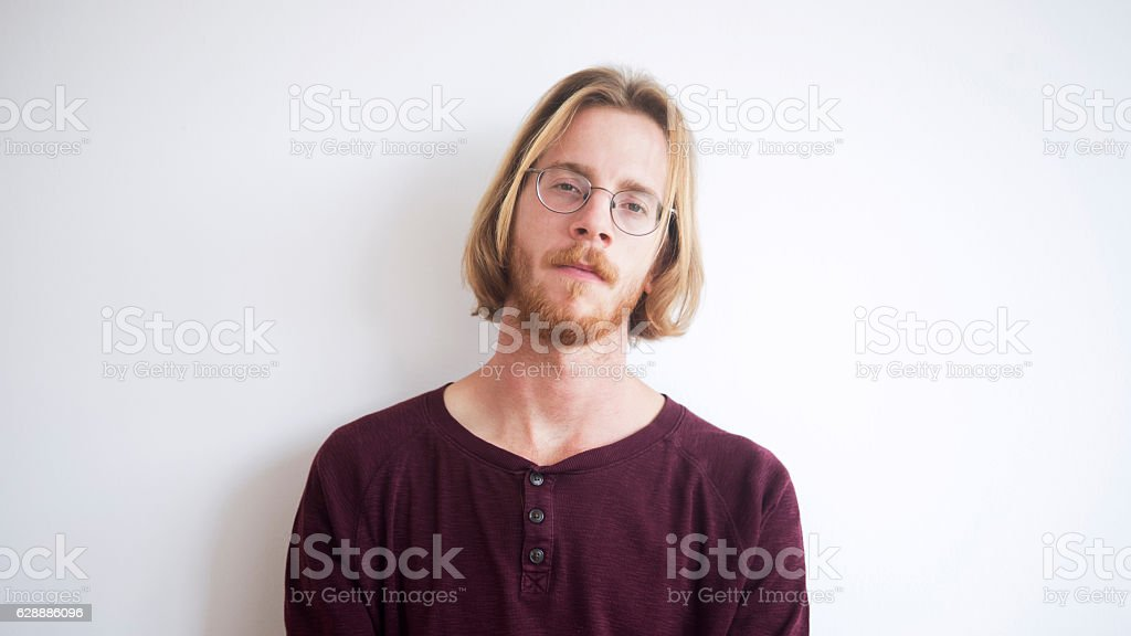portrait of red-haired young man with beard stock photo