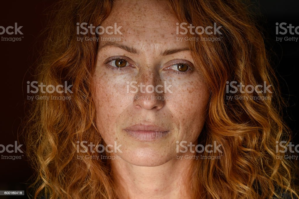 Portrait of redhead melancholic woman stock photo