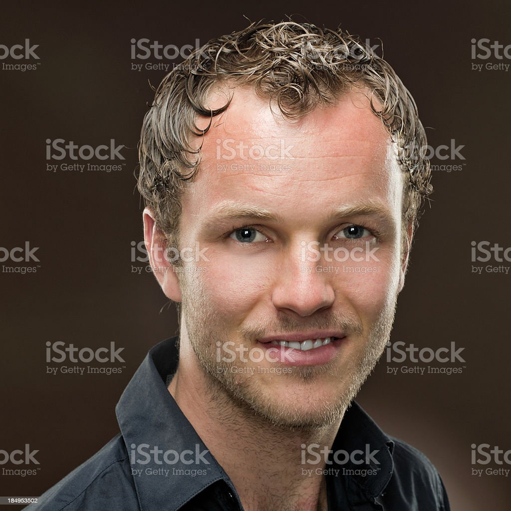 portrait of relaxed smiling man with short curly hair royalty-free stock photo