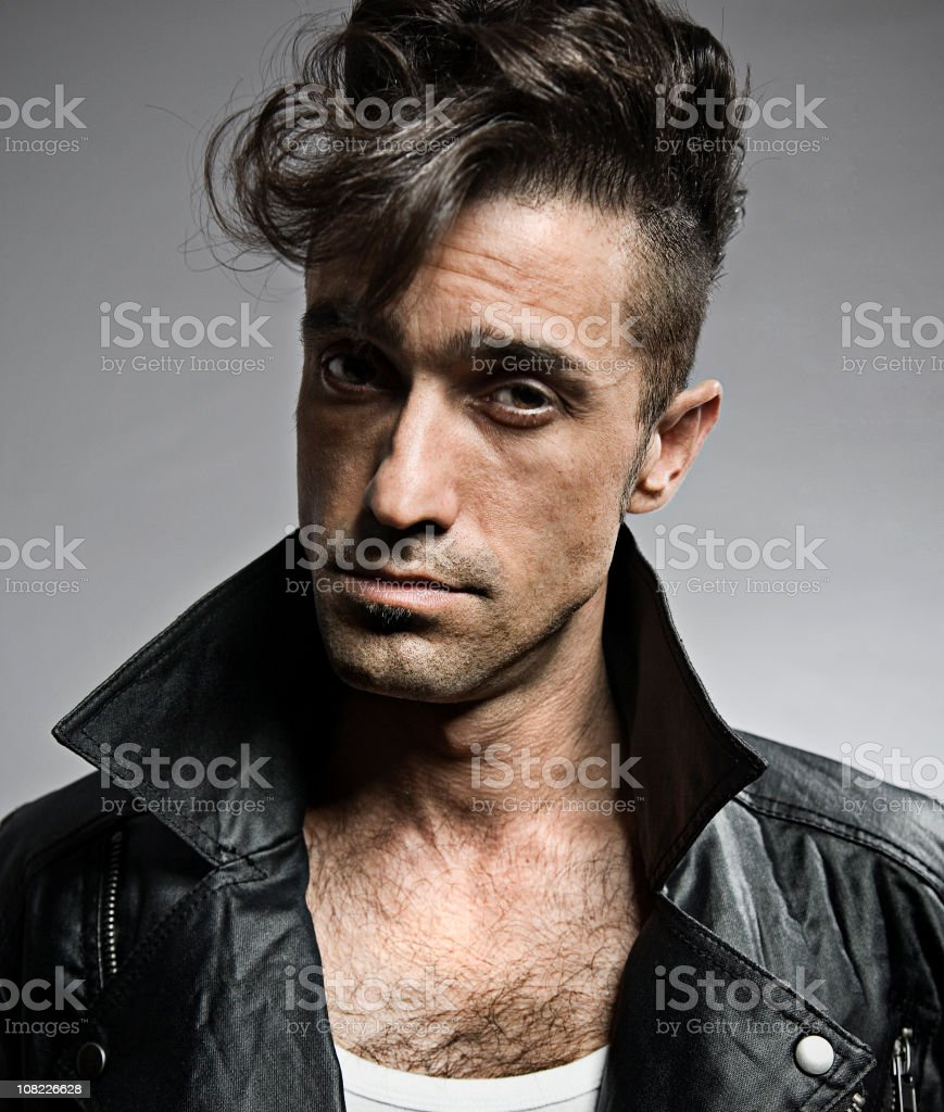 Portrait of Retro Young Man Wearing Leather Jacket stock photo