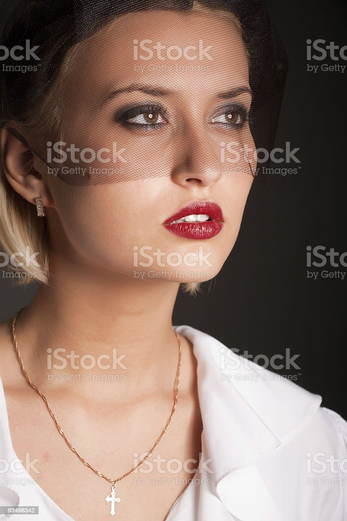 Portrait of retro-style woman in white blouse and black veil royalty-free stock photo