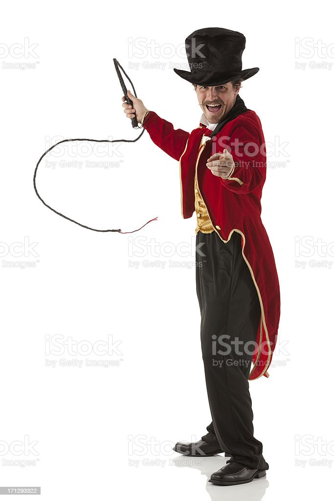 Portrait of ring master performing with a whip stock photo