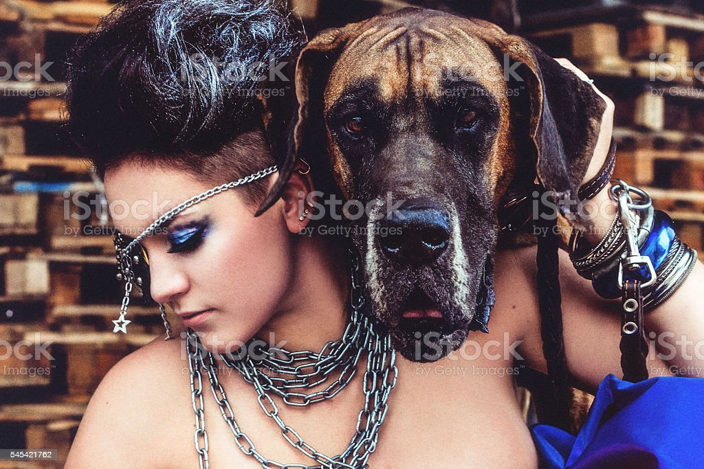 portrait of rock style young woman with dog stock photo
