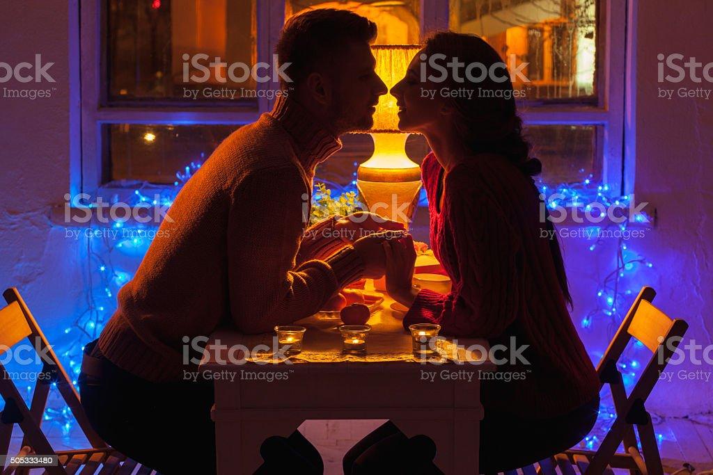 Portrait of romantic couple at Valentine's Day dinner stock photo