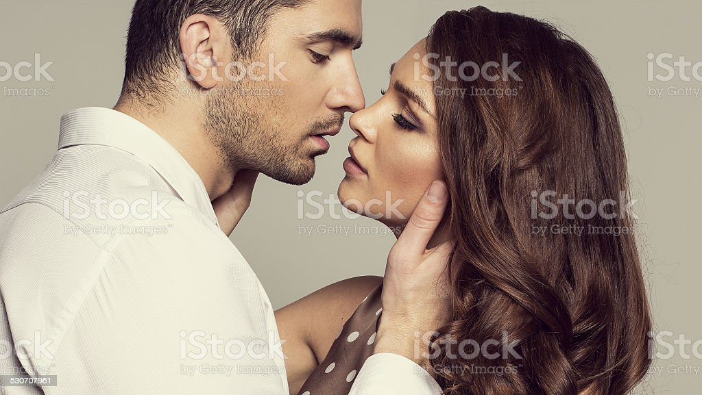 Portrait of romantic couple touching and kissing each other stock photo