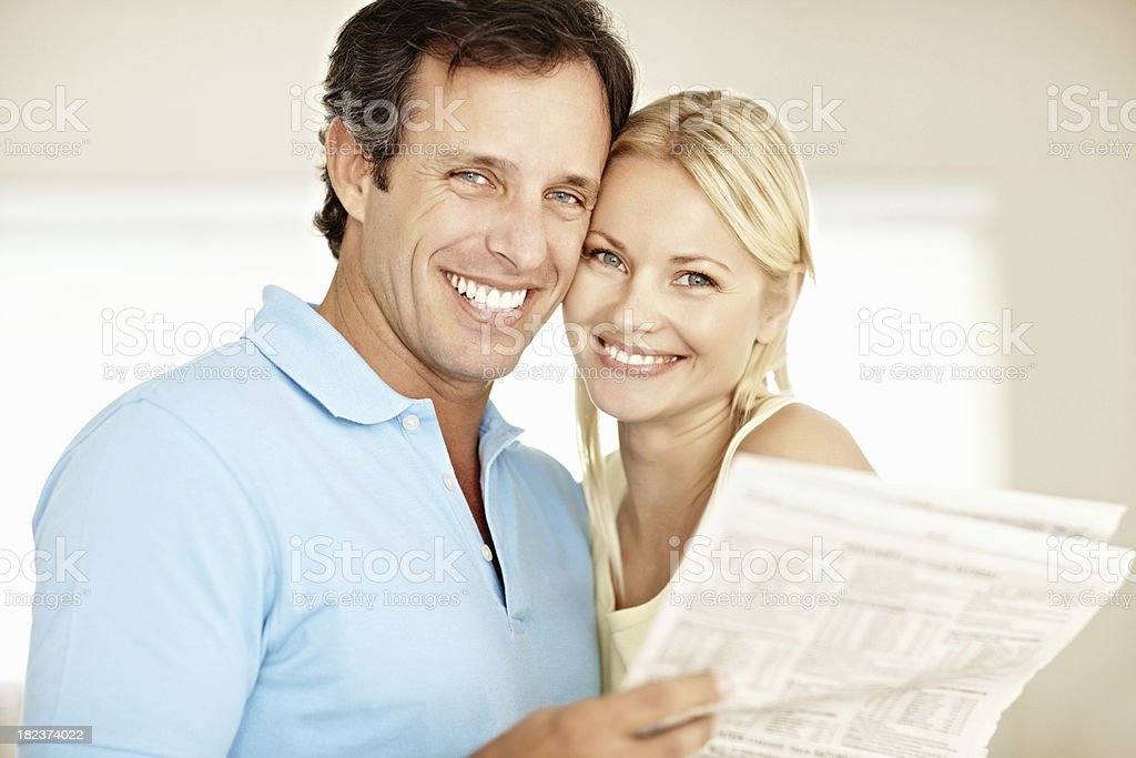 Portrait of romantic couple with newspaper royalty-free stock photo