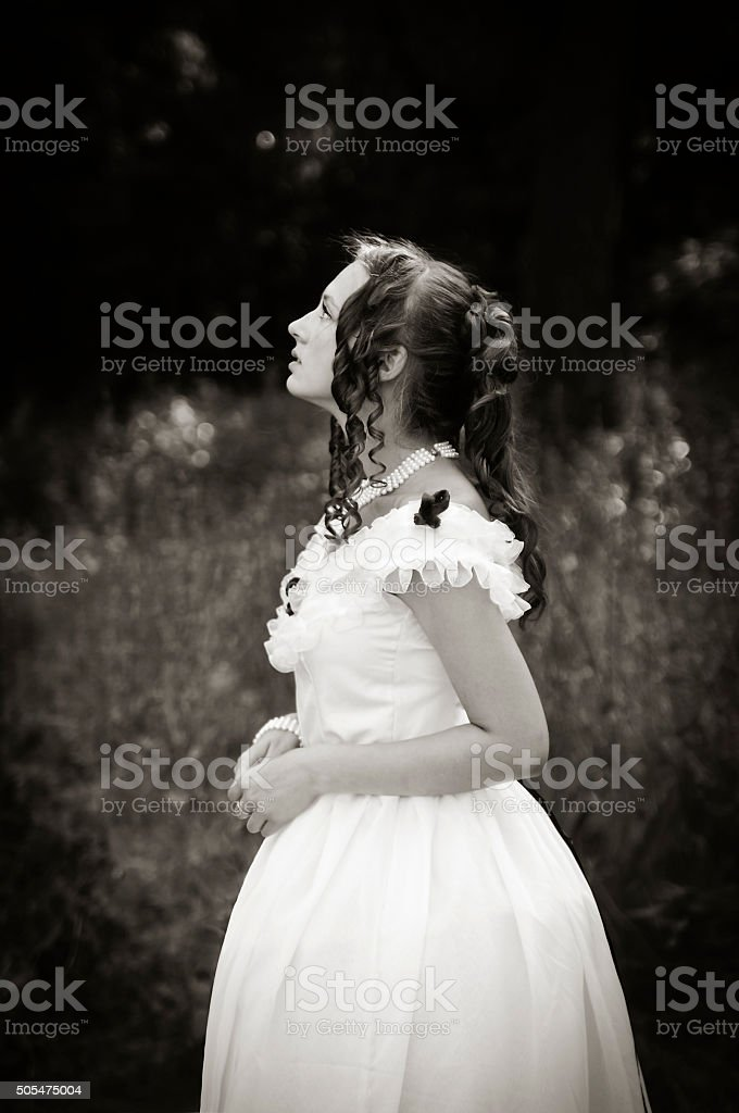 Portrait of romantic girl in a ball gown stock photo