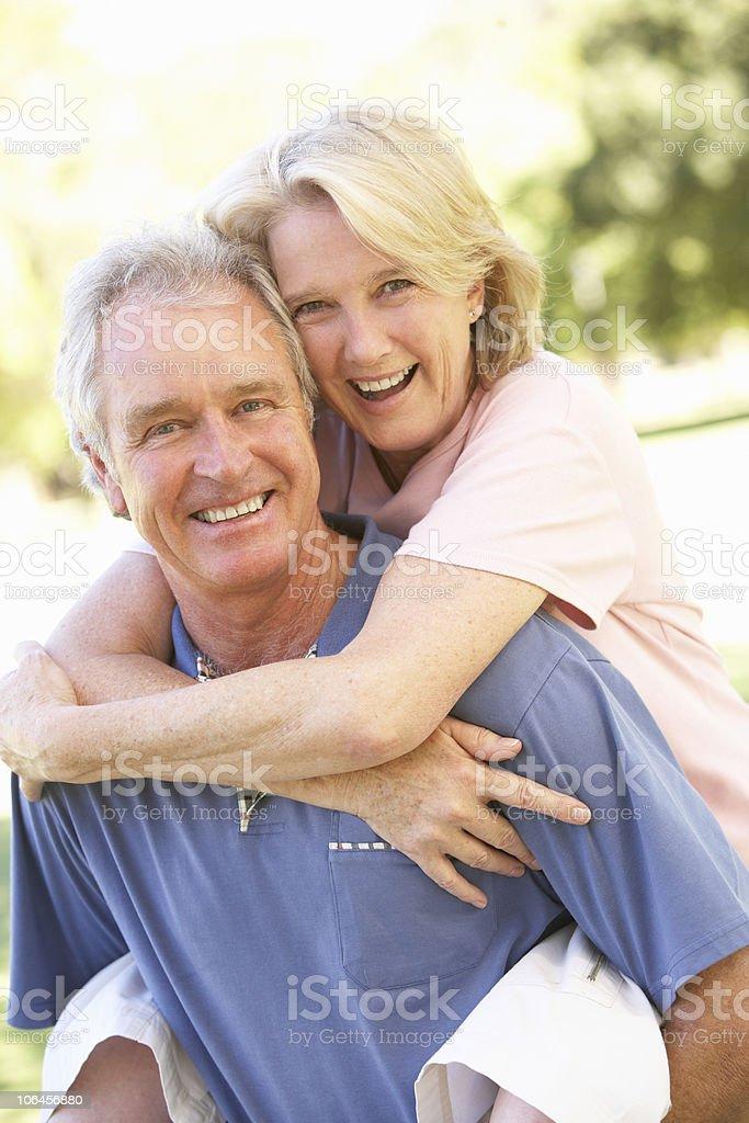 Portrait Of Romantic Senior Couple In Park royalty-free stock photo