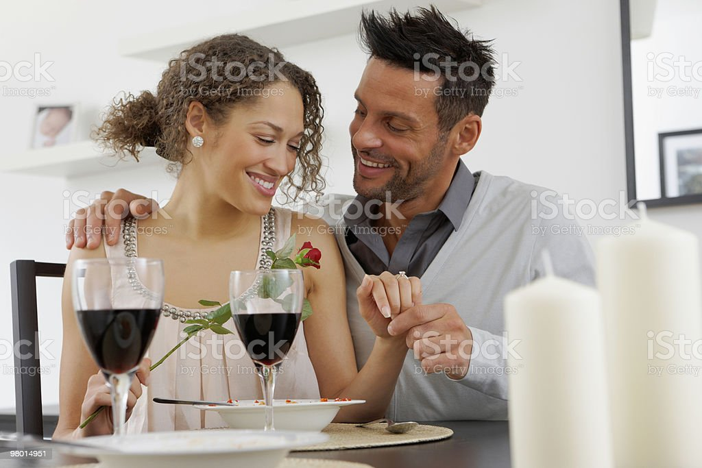 Portrait of romantic young couple at dinning table royalty-free stock photo